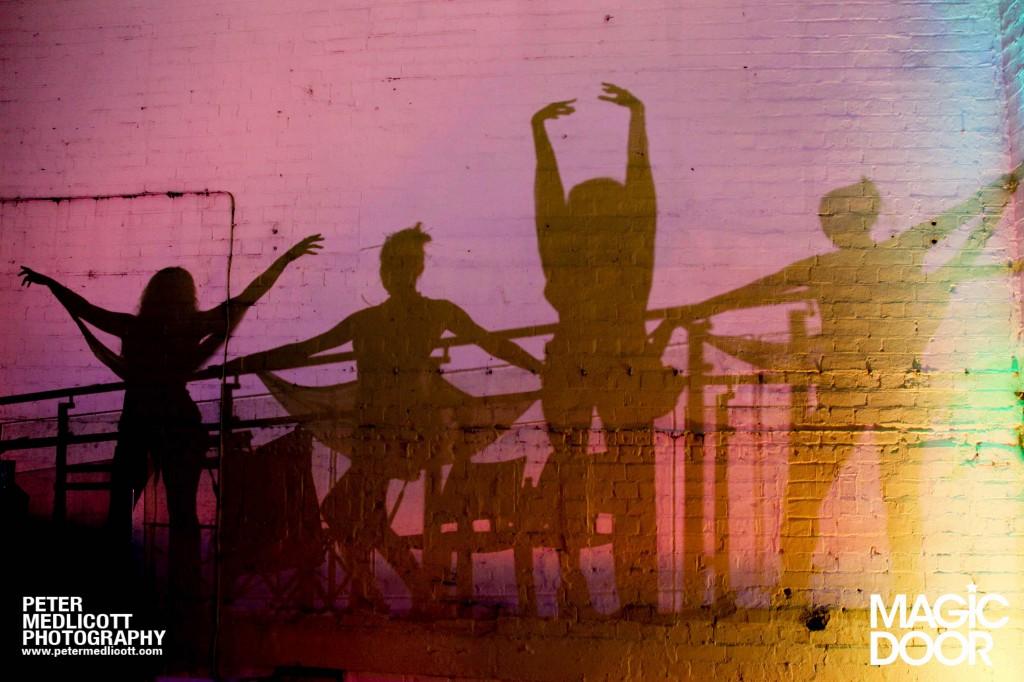 Girls-dancing-in-reflection-shaddow-Magical-Clubbing-Birmingham-Magic-Door-commercial-photographer-Peter-Medlicot