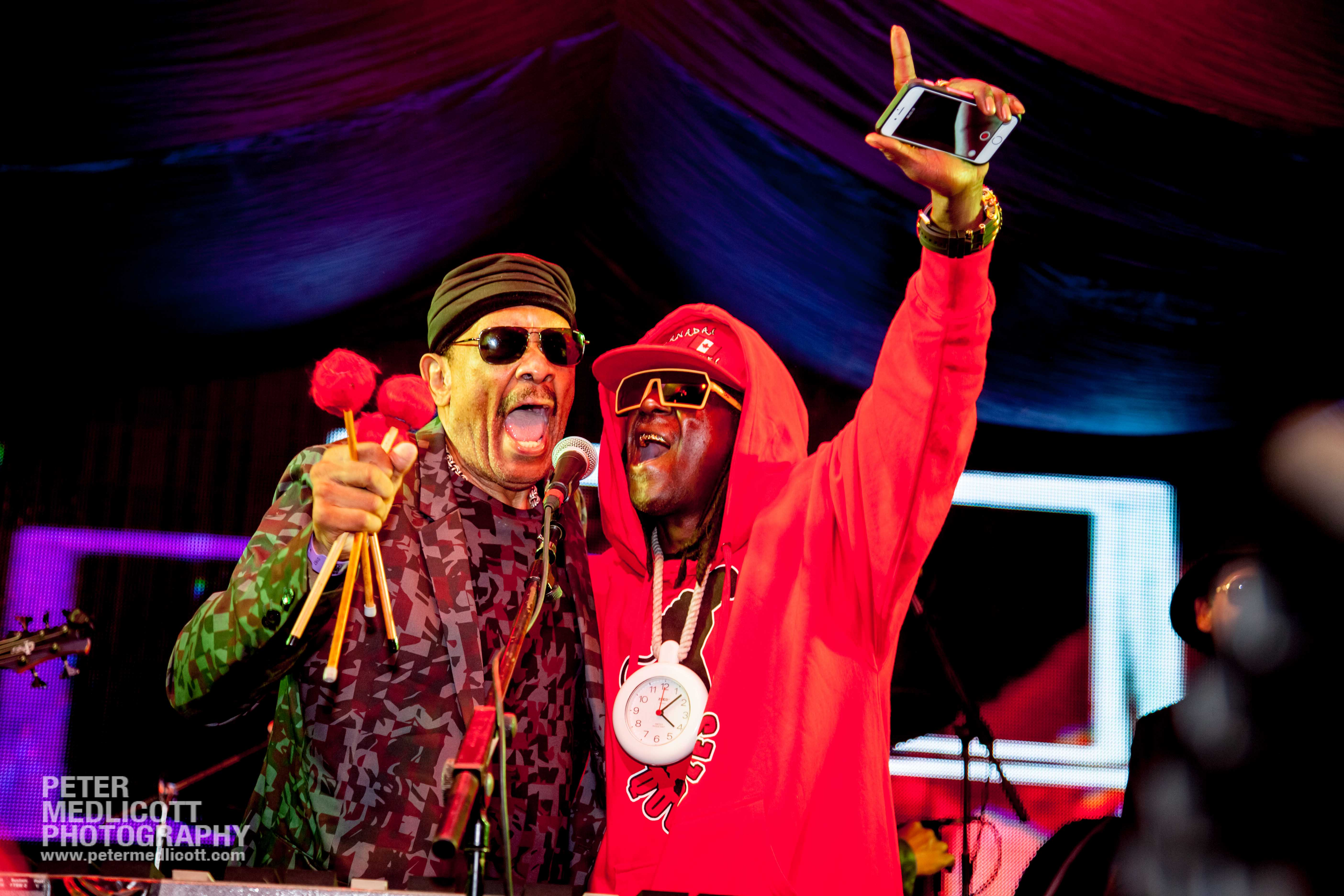 Flava Flav and Roy Ayers sing on stage at Mostly Jazz festival Hip Hop Jazz legends by lifestyle and music photographer Birmingham Peter Medlicott