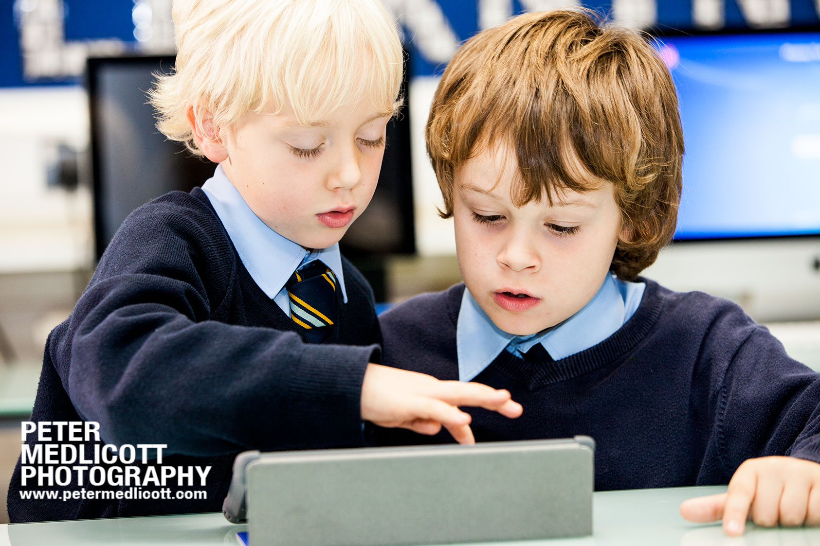 SMART Technologies Children using iPad learning documentary photographer birmingham and London Peter Medlicott