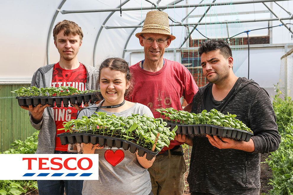 Editorial and PR Photography in Birmingham and London , Community Group gardening for Tesco Magazine holding produce toward camera taken by Peter Medlicott
