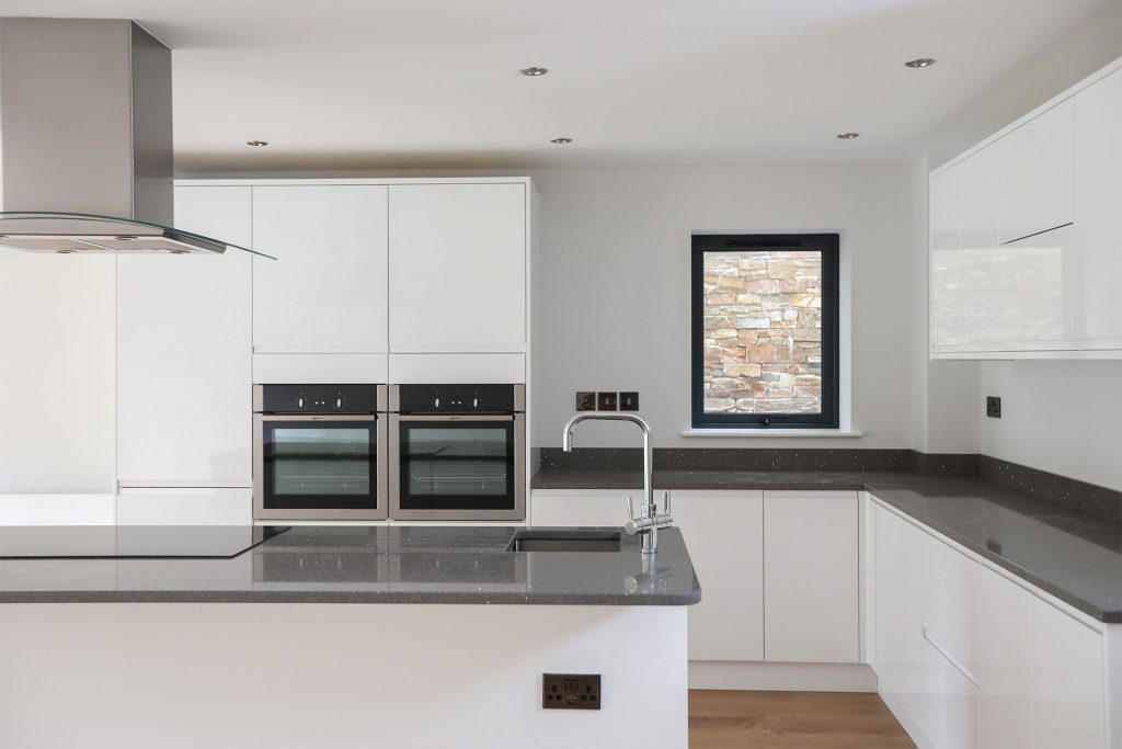 Contemporary Kitchen scene by Interiors and property Photographer in Birmingham, London and Coventry by Peter Medlicott